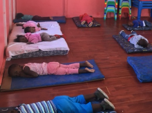 Preschool Children Sleeping on Mats
