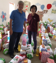 Pastor Ohm and Mrs. Ohm with Christmas Food Parcels